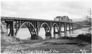 With its three tied arches above the road deck flanked on both sides by three deck arches below the road deck, the original Alsea Bay Bridge was very pleasing to the eye.