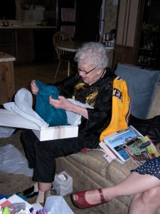 After the birthday dinner, came the presents. Mom received candy and more candy and some beautiful clothes. Her favorite gift was the Laker's jacket with Kobe Bryant's name on it. It is the gold you see in the photo. (Notice the book sitting next to her? Look familiar!)
