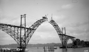 This historic photo shows the Yaquina Bay Bridge's 600-foot main arch almost completed. ––ODOT photo