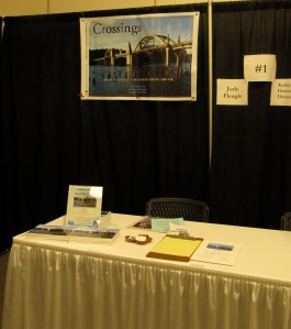 This is my table from last year. This year I'll have my second book, The Crossings Guide, also.