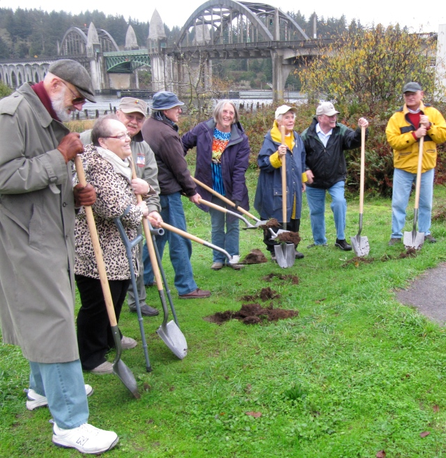 Town dignitaries wielded shovels in the Siuslaw River Bridge Interpretive Wayside groundbreaking ceremonies.