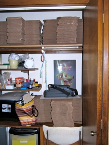 Largest boxes on top of old sewing machine cabinet, three sets of boxes on shelf above (one out of sight(, and 400 white envelopes in box under sewing machine.
