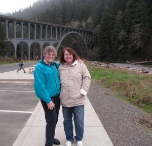 Judy & Barbara at Cape Creek Bridge, enjoying the stoppage of drizzle.