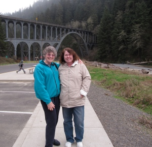 Judy & Barbara at Cape Creek Bridge, enjoying the stoppage of drizzle.