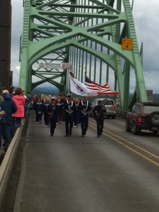 The Coast Guard color guard lead the parade celebrating the 75th Anniversary of the Yaquina Bay Bridge.