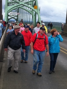 The parade had approximately 1,000 people cross the Yaquina Bay Bridge.