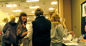 Dr. Veronica Esagui talks to interested folks at her table.