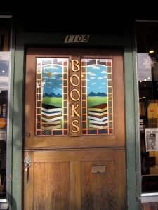 This is the impressive stained-glass window door of Godfather's Books in Astoria.