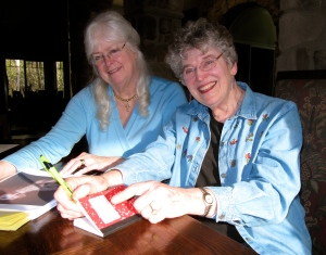 Karen Nichols (left) and I  going over the illustrations that I want in Colorful Animals I Have Known.