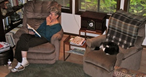 Edna and Groucho relax in the living room with the woodstove going.