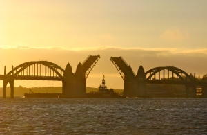 Here the bridge opens for a large barge at sunset. The bridge will remain open to marine traffic. The work bridges will extend on both sides on both ends of the bridge with the middle left open,