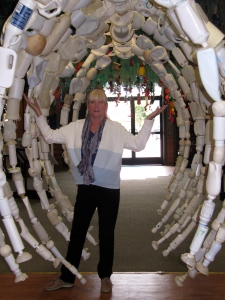 Carole in the ribcage of a whale at the Washed Ashore Museum.