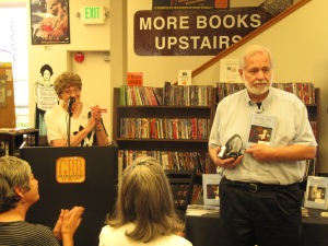 Here Ted is explaining the $5 pledge from Gold Beach Books plus three others to the Curry County Animal Shelter for each copy of Devil Cat sold during the day.