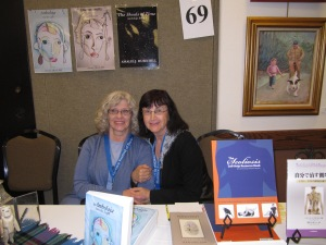 First-timer Amalie Hill shared table with Veronica Esagui who has attended every one since the beginning and was on the Publisher's Panel yesterday.
