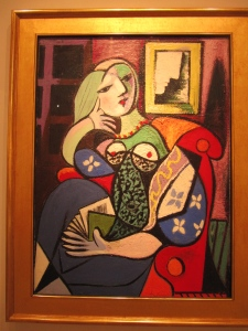 I could tell this was Picasso and discovered that it's called Woman with a Book.